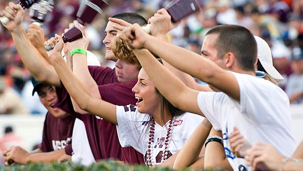 Mississippi State students ring cowbells at a Bulldogs' football game.