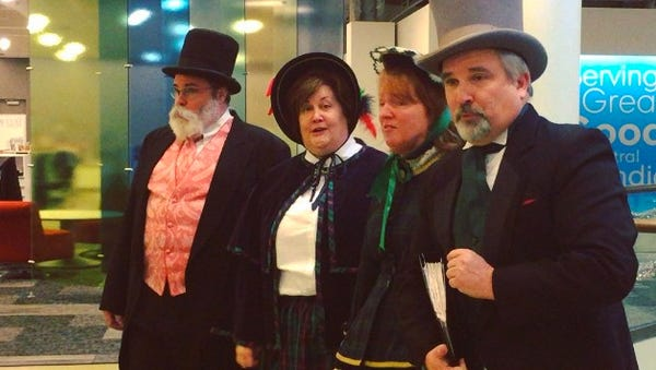 The Dickens Carolers (from left) Dan Shockley, Karen Hall, Jennifer Nicholson and Michael Davidson visited the IndyStar while caroling Downtown.