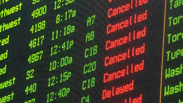A departures board shows mostly cancellations at Nashville International Airport  on Feb. 16, 2015.
