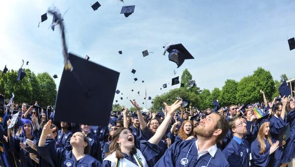In this 2015 file photo, mortarboards go flying after graduation at UNC Asheville.