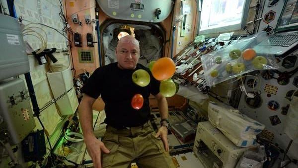 "Astronaut Scott Kelly sent this selfie on Twitter and Instagram after a cargo spaceship brought a resupply of fresh fruit. ""Christmas in July! Great gift for my 100th day in space! Only ~250 more to go (not that I'm counting) #YearInSpace"