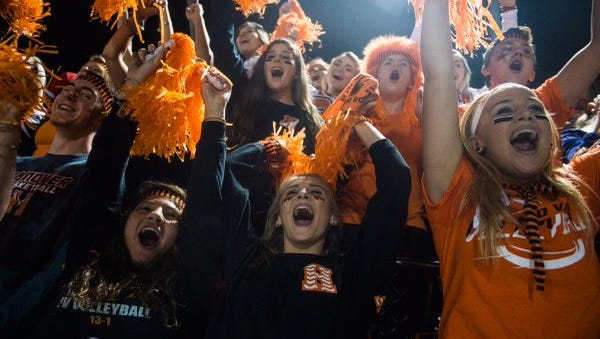 The Hanover student section cheers on their team Friday at Sheppard-Myers Stadium. The Nighthawks beat Delone Catholic 45-20 to clinch a share of the YAIAA Division III championship.