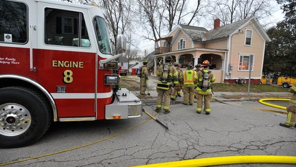 Firefighters respond to a home on River Street in Winooski on Monday to extinguish a stove fire.