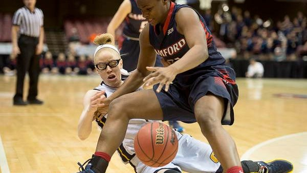 Samford's KeKe Fletcher and Alicia Payne get tangled up while diving for  the ball during Friday's game.