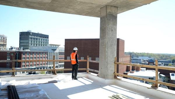 Bo Aughtry of the commerical real estate developer, Windsor Aughtry, looks out from the top floor of the new Embassy Suites hotel located along the Reedy River in downtown Greenville. Monday, March 21, 2016.