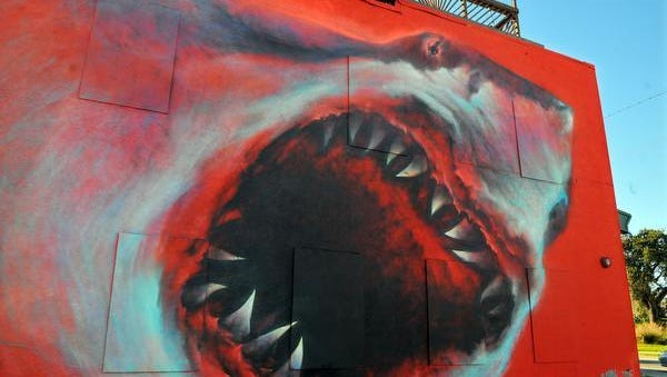 Los Angeles artist Shark Toof painted this mural on the side of an Eau Gallie building.