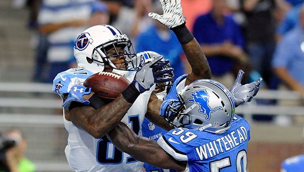 Lions linebacker Tahir Whitehead and safety Rafael Bush were all over Titans receiver Andre Johnson on the game-winning touchdown catch.