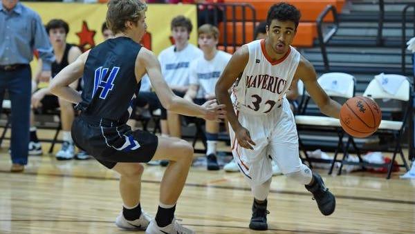 Mauldin's Nate Helton drives down the baseline while defended by St. Joe's Jared Rex. Mauldin hosted St. Joe's in varsity basketball Wednesday, Dec. 7, 2016.