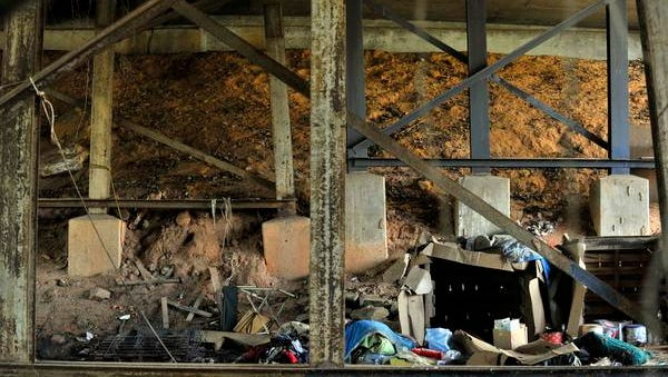 Under a bridge on Wade Hampton Blvd., a homeless man died after the tarp covering his camp site caught fire and fell on him. Current look at the site on Thursday, November 20, 2014.