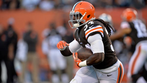 Cleveland Browns running back Isaiah Crowell runs the ball against the Oakland Raiders in the third quarter of an NFL football game Sunday, Oct. 26, 2014, in Cleveland. (AP Photo/David Richard)