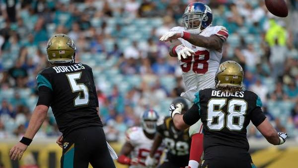 Giants defensive end Damontre Moore (98) blocks a pass by Jaguars quarterback Blake Bortles during Sunday's 25-24 loss in Jacksonville, Florida.