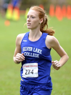 Silver Lake College cross country runner Abby Gerhard of Iron Mountain, Michigan, competes in the Wisconsin Private College Championships on Saturday in Kenosha.