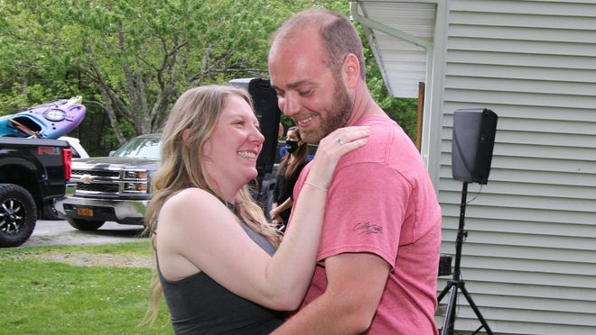 Colleen Carey and Anthony Chessari Jr. dance in their Bloomingburg backyard on what would have been their wedding day Friday. Their DJ, Brian Stylez, set up shop outside the couple's home to play them their first dance.