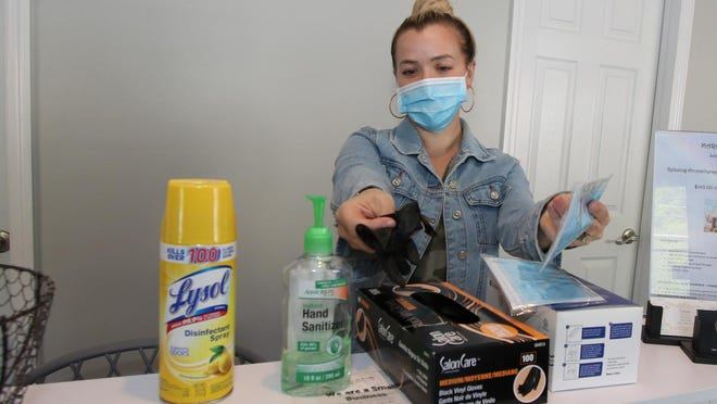 Sarah O'Flaherty, owner of Angels on Earth Salon & Spa in Newburgh, is getting the salon ready for opening by having masks, gloves and sanitizers on hand for customers when they return.