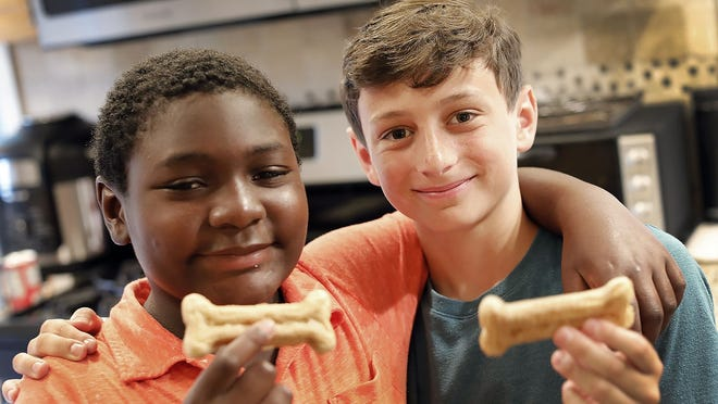 Friends Daniel Grant (orange shirt) and Max Caponigro (green shirt) both ten of Milton make dog treats which they sell locally to benefit a food bank.  Monday June 29,  2020 Greg Derr/The Patriot Ledger