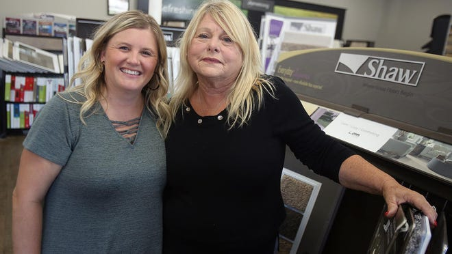 Maxine Norville and daughter, Ashley Stroup, remember the late Walter Norville at Walter Norville Carpets and Floor coverings on Tuesday. Walter passed away after having complications from the COVID-19 virus.