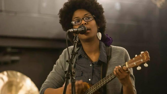 Musician Cammy Enaharo sings and plays at small venues and festivals in Rochester.
