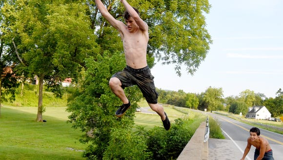 Cole Frizzell, 16, of Fishersville takes a flying leap