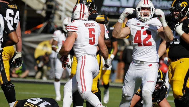 Wisconsin Badgers linebacker T.J. Watt (42) reacts after Iowa Hawkeyes quarterback C.J. Beathard is sacked in the second half.