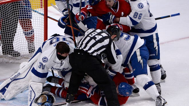 Montreal Canadiens forward Brendan Gallagher (11) collides with Tampa Bay Lightning goalie Ben Bishop (30) during the third period at the Bell Centre.