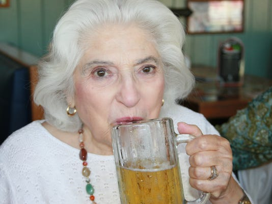 Elderly woman with beer