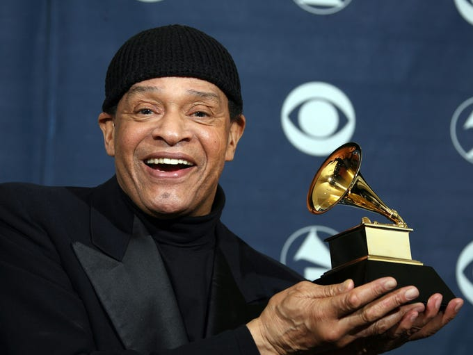 Singer Al Jarreau poses with his trophy at the 49th