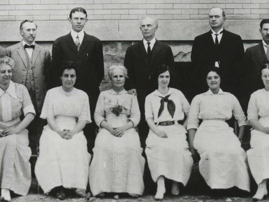 Michael D. Kelly, second from right, in 1913 with faculty