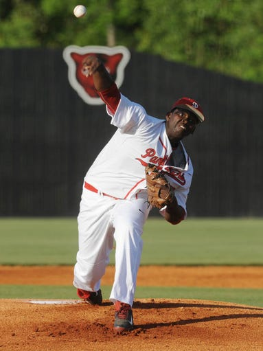 Petal's DeMarcus Evans (42) pitches against Ocean Springs Friday night in a Class 6A playoff game.