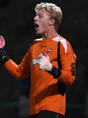 Florida Gulf Coast University goal keeper Jared Brown (30) celebrates a block of a penalty kick against the University of South Florida in the first round of the NCAA soccer tournament at  Corbett Stadium.