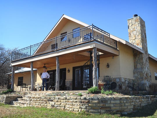 Leo Lane stands on the back patio of the Lane Family home near Buffalo Springs in Clay County. Lane's parents began buying land in the area in the 1970s and built the two story house several years ago.