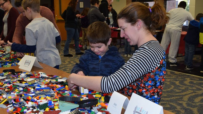 Donna Keane and Connor Keane, 5, of Clayton work on the Lego Challenge while visiting Makers Day at the Vineland Public Library on Saturday, March 10.