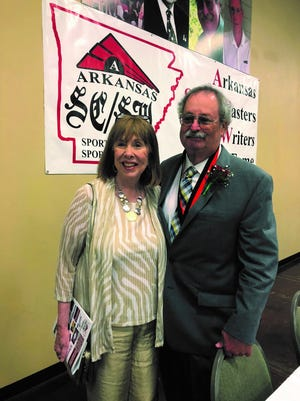 Nate Allen (right) is pictured with his wife, Nancy, at his induction into the Arkansas Sportscasters/Sportswriters Hall of Fame last week in Conway. Allen has appeared as your source for Razorbacks' news in The Bulletin for more than 15 years.