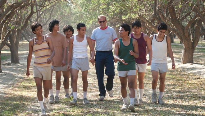 """Coach Jim White (Kevin Costner) whips his cross-country newbies into championship shape in """"McFarland, USA."""""""