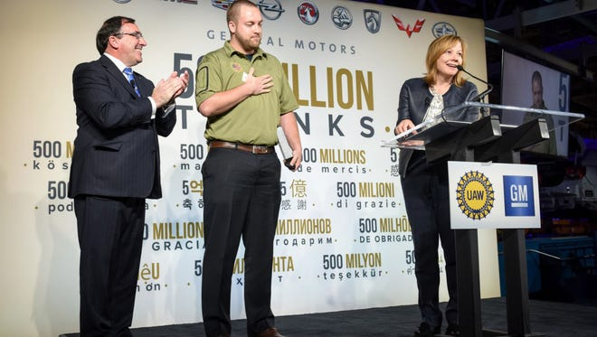 Purple Heart recipient Trent Brining received an all-new 2016 Chevrolet Malibu from GM CEO Mary Barra and Alan Batey, president of GM North America.