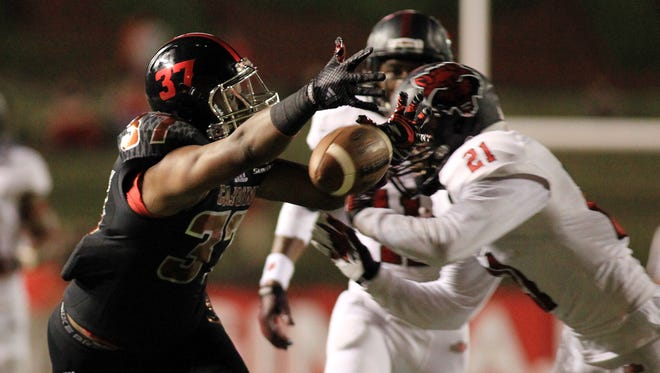Arkansas State's Andrew Tryon (21) breaks up a pass to UL tight end Matthew Barnes (37) during a 2014 game at Cajun Field.