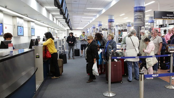 Stranded air passengers wait in line for refunds at the Atlantic City International Airport on Jan. 21, 2014, after snow caused delays and cancellations.