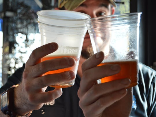 Mike Lee, an Ocean City local, cheers a friend at the