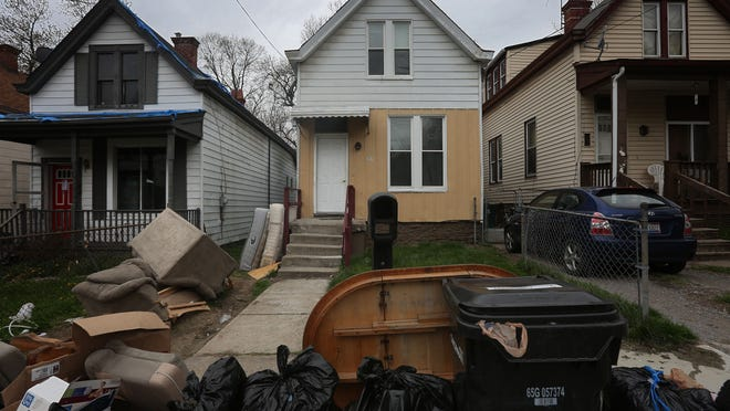 The home on Hackberry Street, in East Walnut Hills, where 2-year-old Glenara Bates was starved and tortured. According to a neighbor, everything that was in the home was placed outside by the landlord for trash pickup. The girl's parents, Andrea Bradley and Glen Bates, face murder charges in the girl's death. Glenara was tortured for most of her life, officials said. She was beaten severely, starved and made to sleep in a bathtub containing feces and blood. When she was taken to a Cincinnati hospital March 29, the day she died, she weighed 13 pounds.