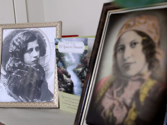 Two portraits sit atop a dresser in Asya Titova's room