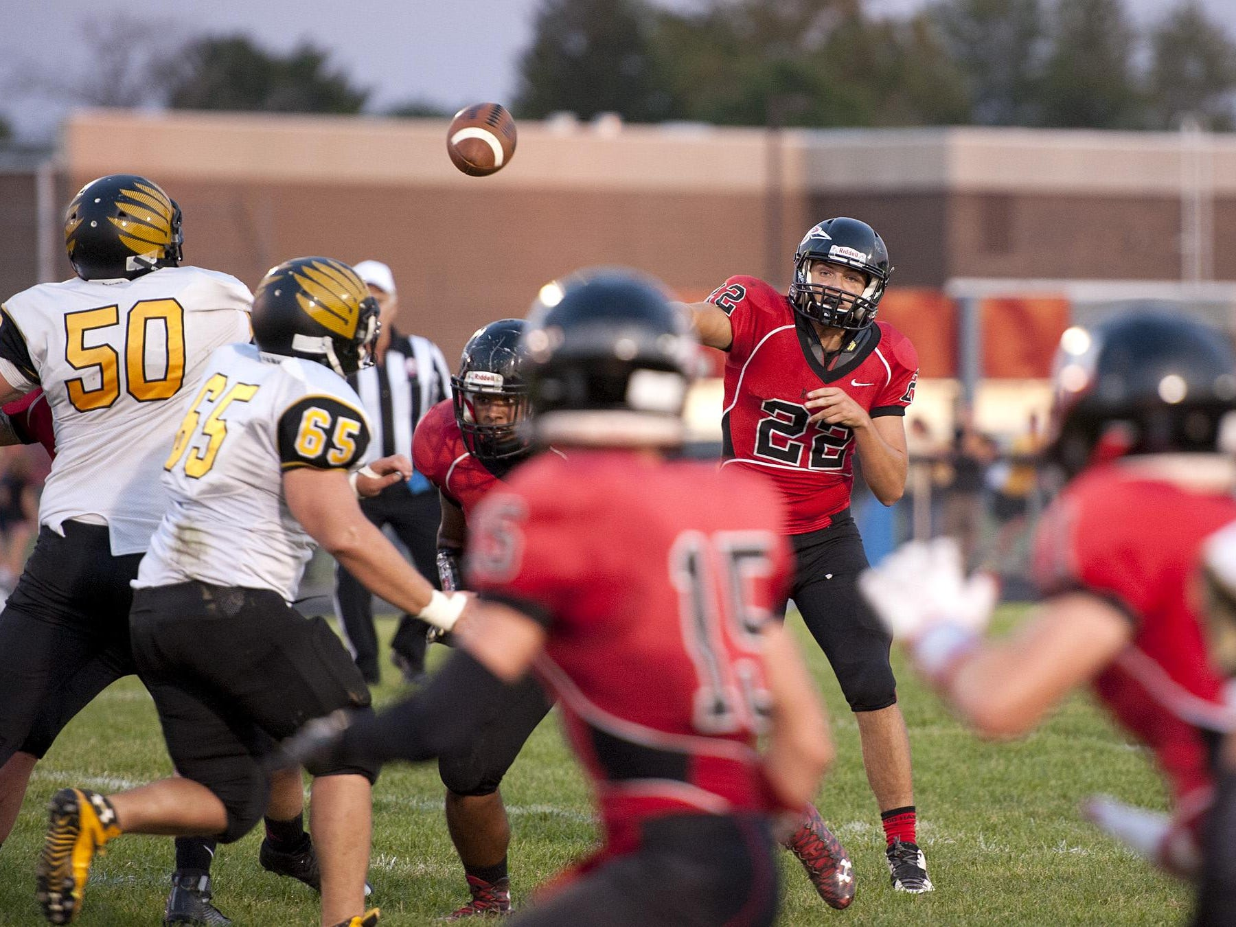 Bucyrus quarterback, Gavin Lewis, throws the ball in the first quarter.