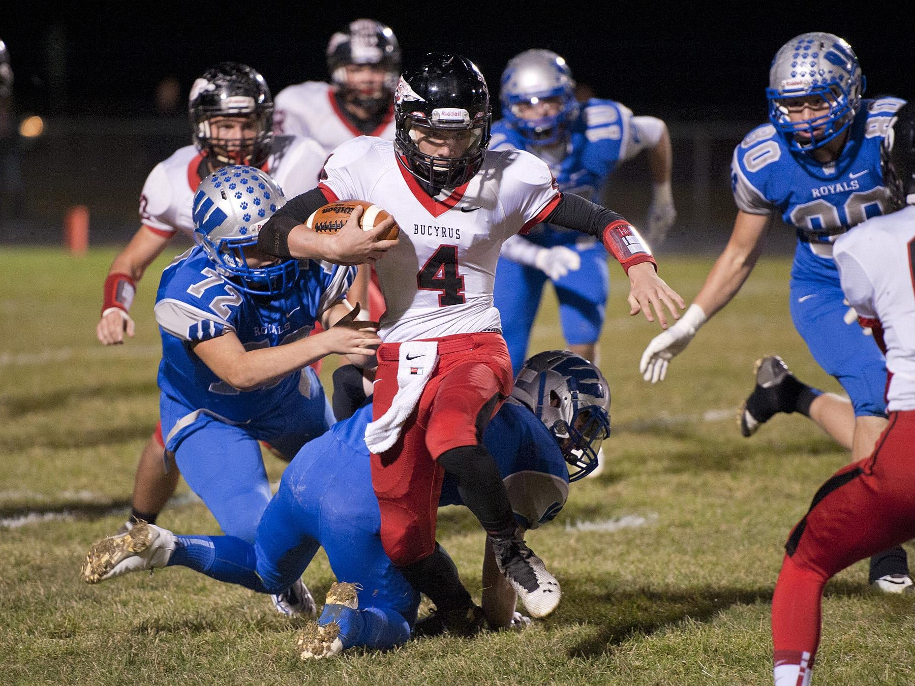Bucyrus' Damon Parsell runs the ball early in the first quarter.