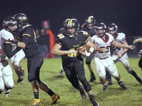Blake Treisch runs the ball against Bucyrus earlier