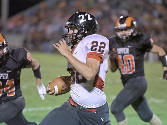 Bucyrus quarterback Gavin Lewis runs the ball against