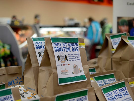 Donation bags during the Defeat Hunger Bowl event with Green Bay Packers tight end Andrew Quarless at the Walmart Supercenter in De Pere.