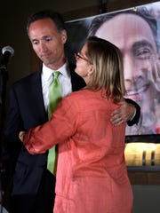 David Fox gets a hug from his wife, Carrington, as he delivers his concession speech after losing to Megan Barry in the mayoral runoff election Sept. 10 in Nashville.