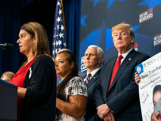 "President Donald Trump listens as ""Angel Families"" make remarks at the Eisenhower Executive Office Building in Washington Friday."