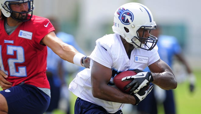 Titans running back Bishop Sankey takes a handoff from quarterback Charlie Whitehurst during practice on Aug. 3.