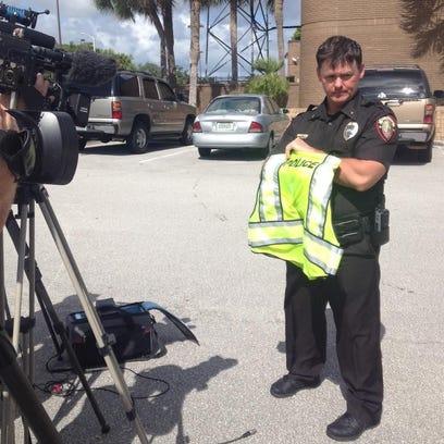 Commander Dan Lynch showing the type of vest Lt. Steve