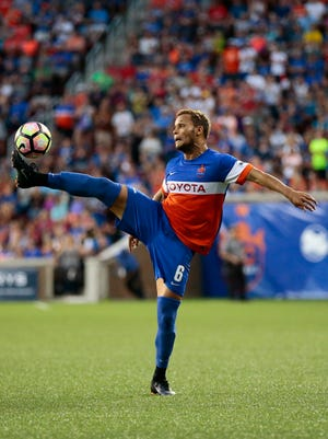 FC Cincinnati's Kenney Walker (6) takes a pass in the second half of the USL soccer match between FC Cincinnati and the Rochester Rhinos at Nippert Stadium in Cincinnati on Saturday, July 29, 2017.