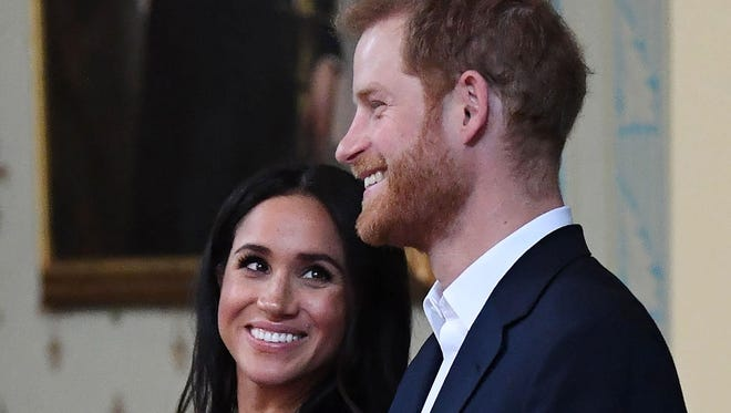 In this file photo taken on October 18, 2018 Britain's Prince Harry and Meghan, Duchess of Sussex attend a reception at Government House in Melbourne, Australia.